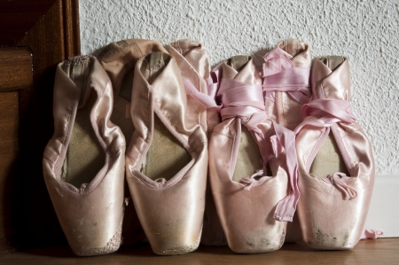 Group of pointe shoes leaned against the wall Stock Photo - 18727282