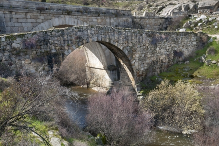 viejo: Grajal Bridge over the river Manzanares, Colmenar Viejo, Madrid Province, Spain  It was built in Middle Age, during the Muslim domination of the Iberian Peninsula