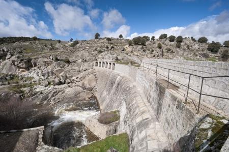 viejo: Concrete dam wall over the river Manzanares, Colmenar Viejo, Madrid Province, Spain Stock Photo