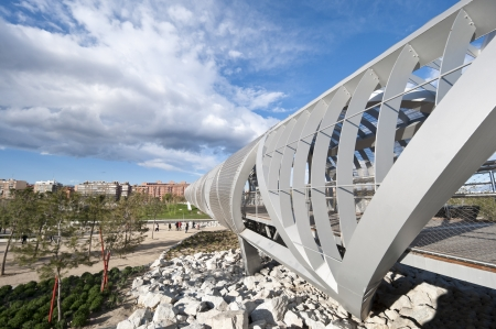 MADRID – APRIL 15  Arganzuela Bridge on 15 April, 2013 in Madrid Rio Park, Madrid, Spain  Designed by Dominique Perrault, it is 274 metres in lenght and formed by two spiral-shaped walkways connected by a hill giving access to Arganzuela Park   Editorial