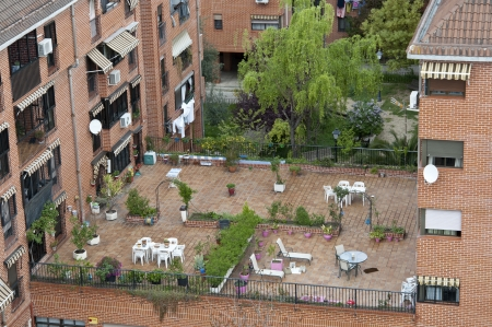 communal: Communal terrace between buildings in Carabanchel suburb, Madrid, spain Stock Photo