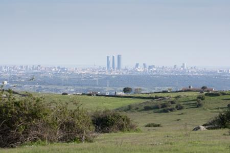 viejo: Views of Madrid City from Dehesa de Navalvillar, Colmenar Viejo Countryside, Spain  Stock Photo
