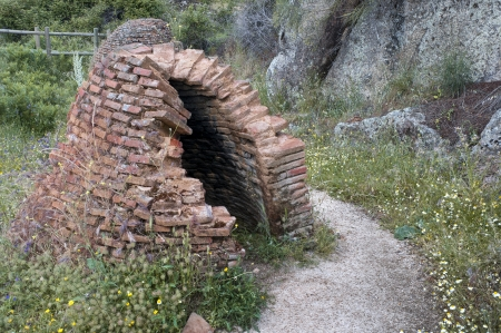 brick kiln: Old rest of a peguera  They were ancient brick kilns where pitch was produced   Photo taken in Iruelas Valley Natural Park, Avila, Spain