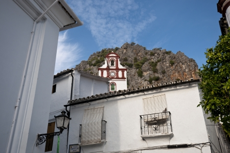 Traditional houses in Ubrique, Cadiz, with the San Antonio church at the background  This village is part of the pueblos blancos  white towns  in southern Spain Andalusia region, and reminds the Arab past  photo