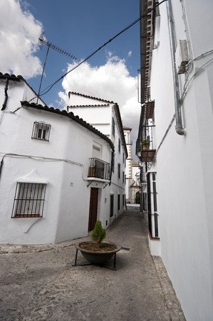Traditional white houses in Grazalema town, Spain  This village is part of the pueblos blancos -white towns- in southern Spain Andalusia region  photo