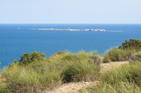 islet: Views of Tabarca islet from Santa Pola town, Alicante, Spain. It is the smallest permanently inhabited islet in Spain