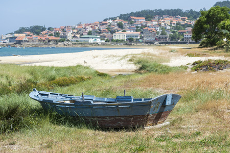 beached: Fishing boat beached on the sand. Photo taken in Aldan, Cangas de Morrazo, Vigo estuary, Pontevedra, Spain Stock Photo