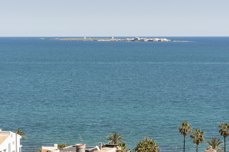 permanently: Views of Tabarca islet from Santa Pola town, Alicante, Spain. It is the smallest permanently inhabited islet in Spain