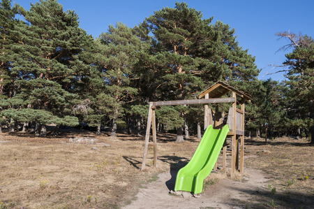 playpen: Slide in a recreational area in Canencia mountain pass, Madrid, Spain Stock Photo