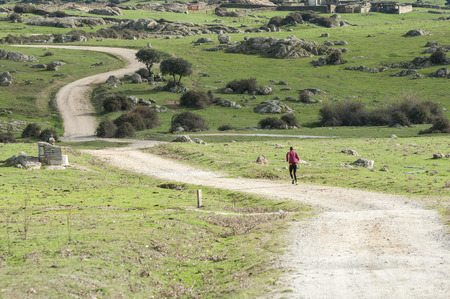 viejo: Man running on a dirt road. Photo taken in Dehesa de Navalvillar, Colmenar Viejo, Madrid, Spain