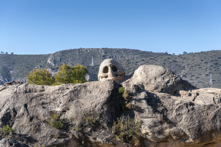 ruta: Sculptures carved on sandstones in the Ruta de las Caras, Route of the Faces, a hiking route at the shore of Buendia Reservoir, Cuenca, Spain Stock Photo