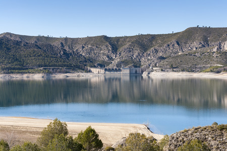 Views of Buendia Reservoir, in the upper waters of the river Tagus, Cuenca, Castilla La Mancha, Spain. The surface area of the reservoir measures 8,194 hectares, and it can hold a total of 1,638 cubic hectometres Stock Photo