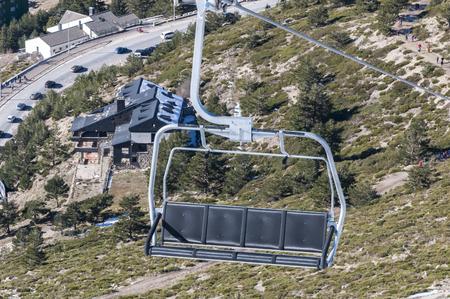chair on the lift: Chair lift in Navacerrada Ski Resort, Navacerrada Mountain Pass, Madrid, Spain, on January 4, 2015