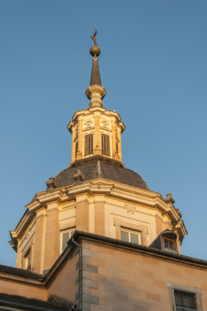 architecture monumental: Detail of a tower of the Royal Palace of La Granja de San Ildefonso, Segovia, Spain. It is an 18th-century palace in a restrained baroque style surrounded by extensive gardens in the French manner and sculptural fountains Stock Photo
