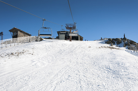 sierra: Chair lift in Navacerrada Ski Resort, Navacerrada Mountain Pass, Madrid, Spain, on January 4, 2015.