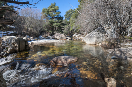 The River Manzanares along its course through La Pedriza, in Guadarrama Mountains National Park, Madrid, Spain