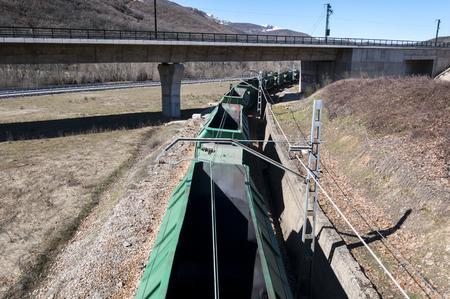 ballast: Freight train on an Iberian gauge railway track between Leon and Gijon on its way through La Pola de Gordon, Leon Province, Spain, on March 6, 2015 Stock Photo