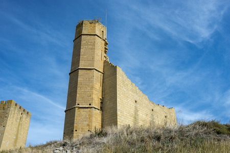 Ruins of the lookout tower (center of the picture) and Homage tower (on the left) of the Uncastillo Castle. It is a historic town and municipality in the province of Zaragoza, Aragon, eastern Spain. In 1966 it was declared a Historic-Artistic site