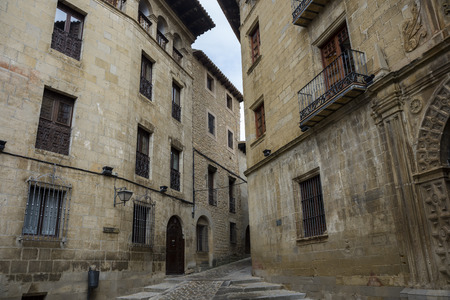 Traditional architecture in Sos del Rey Catolico. On the right can be seen the Town Hall, built at the end of the XVI century in Renaissance style. It is a historic town and municipality in the province of Zaragoza, Aragon, eastern Spain.