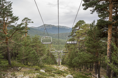 Chairlift in El Bosque ski slope, in Guadarrama Mountains National Park, province of Segovia, Spain