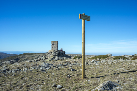 Triangulation pillar in the Pico del Nevero (Snowfield Peak; 2.209 metres) in Guadarrama Mountains National Park, Spain Stock Photo