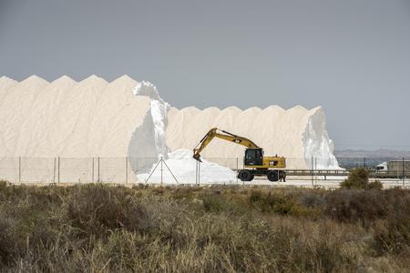 Backhoe working in a salt factory in Santa Pola, Alicante, Spain, on July 21, 2016