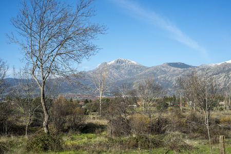 Views of the city of Cerceda, in the province of Madrid, Spain. In the background it can be seen The Maliciosa Peak, with 2.227 m. Stock fotó