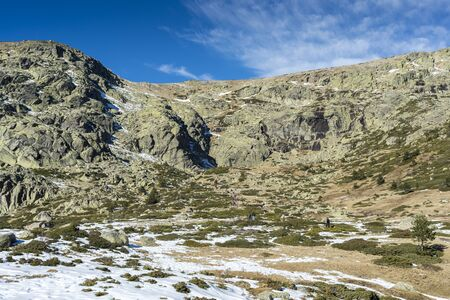 RASCAFRIA, SPAIN - DECEMBER 28, 2016: Hikers in the hiking route to the Laguna Grande de Penalara (Penalara Lagoon) in Rascafria. It is located in the municipality of Rascafria, Guadarrama Mountains National Park, province of Madrid, Spain Stock Photo