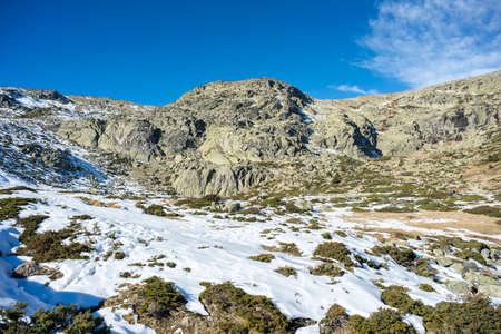 RASCAFRIA - DECEMBER 28, 2016: Hikers in the hiking route to the Laguna Grande de Penalara (Penalara Lagoon) in Rascafria, on December 28, 2016. It is located in the municipality of Rascafria, Guadarrama Mountains National Park, province of Madrid, Spain Editorial