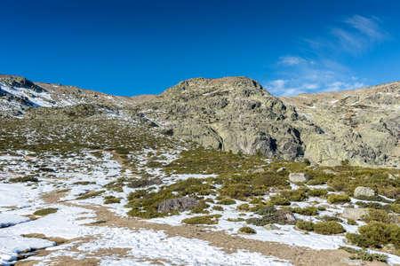 Views of the Penalara Massif, near to the Laguna Grande de Penalara (Penalara Lagoon). It is located in the municipality of Rascafria, Guadarrama Mountains National Park, province of Madrid, Spain