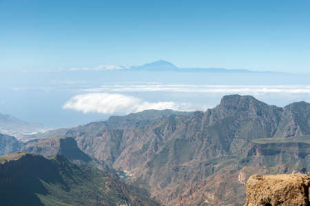 Views of the Mount Teide, in Tenerife Island, form the Nublo Rural Park, in the interior of the Gran Canaria Island, Canary Islands, Spain Views of the Mount Teide, in Tenerife Island, form the Nublo Rural Park, in the interior of the Gran Canaria Island, Canary Islands, Spain