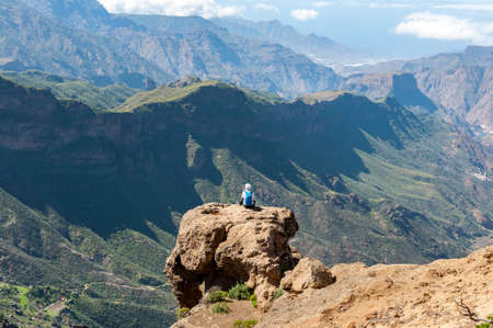 TEJEDA - FEBRUARY 18, 2017: Tourists in the Nublo Rural Park, in the interior of the Gran Canaria Island, Tejeda, Canary Islands, Spain, on February 18, 2017