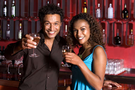 Man and woman extending a toast
