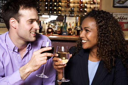 Businessman and businesswoman toasting champagne