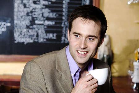 Empresario con una taza de caf�  LANG_EVOIMAGES
