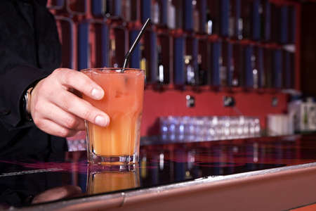 Bartender with a glass of drink