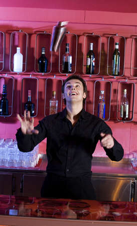 throw up: Bartender mixing drink LANG_EVOIMAGES