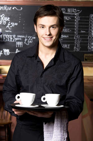 Waiter with two cups of coffee on the tray Stock Photo - 3194169