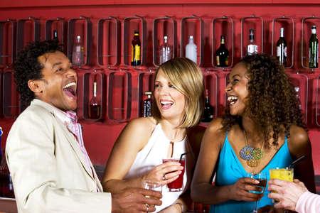 Man and women having fun talking and laughing LANG_EVOIMAGES