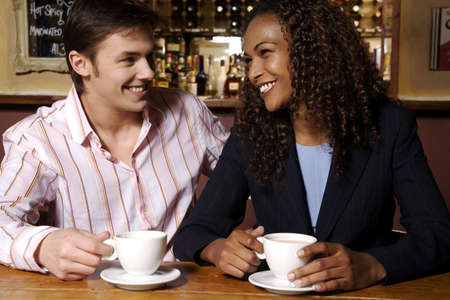 Man and woman enjoying their coffee LANG_EVOIMAGES