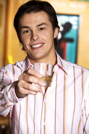 Businessman with a glass of alcoholic drink LANG_EVOIMAGES