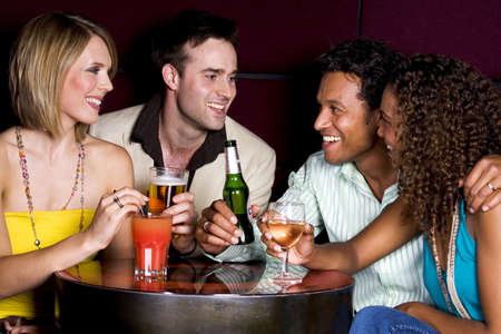 Men and women hanging out in a bar