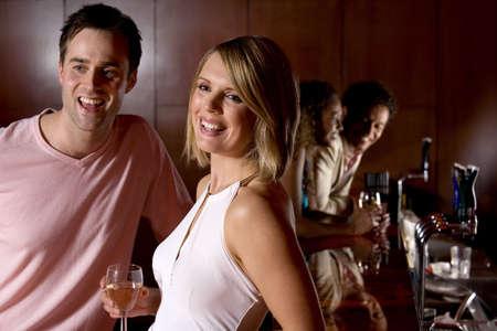side bar: Man and woman enjoying a drink in a bar