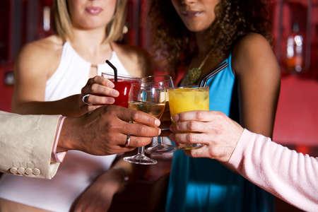 Friends toasting drink LANG_EVOIMAGES