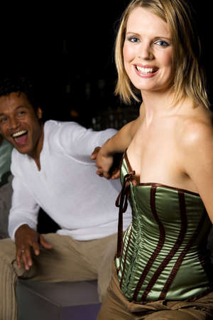 Woman trying to get man to the dance floor LANG_EVOIMAGES