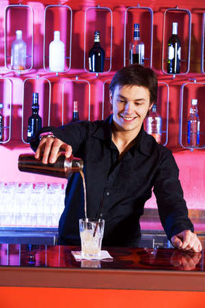 cocktail shaker: Bartender pouring cocktail