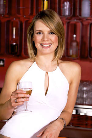 Woman with a glass of alcoholic drink