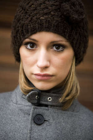 Woman in warm clothing looking at the camera