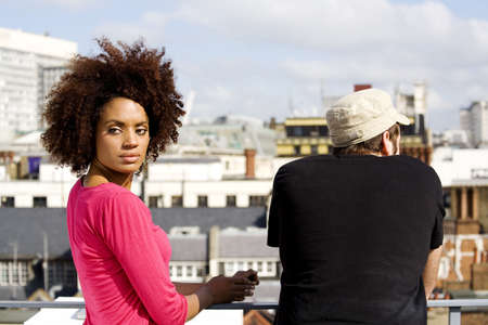 Man and woman hanging out at the rooftop LANG_EVOIMAGES