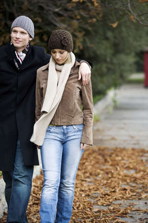 couple winter: Man and woman walking in the park